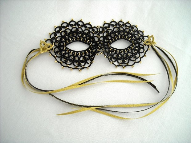 Black Mask, cotton and polyester thread, glass beads, ribbon, 7