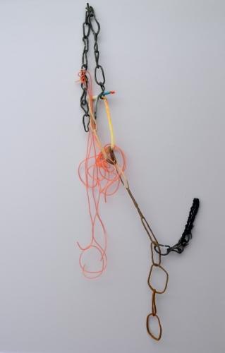 """""""Marsha's Garland""""; Silicone, hand-felted rope, nylon, stoneware, acrylic tubing, eyelashes, cosmetics; 40 x 20 x 3 inches"""
